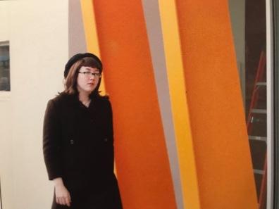 She walked north towards Jenne Magafan's mural blocks away.